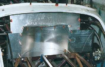 Rear boot bulkhead with spare wheel space.