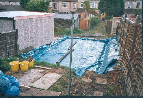 Plastic sheeting for the concrete base.